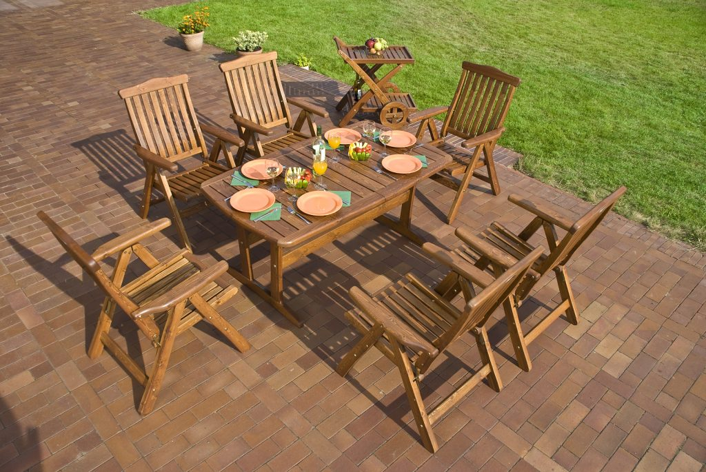 Garden with reclaimed teak outdoor furniture